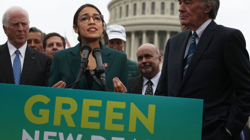 Rep. Alexandria Ocasio-Cortez (D-N.Y.), joined by Sen. Ed Markey (D-Mass.), right, and other congressional Democrats, discusses the Green New Deal at a news conference in front of the Capitol on Feb. 7.