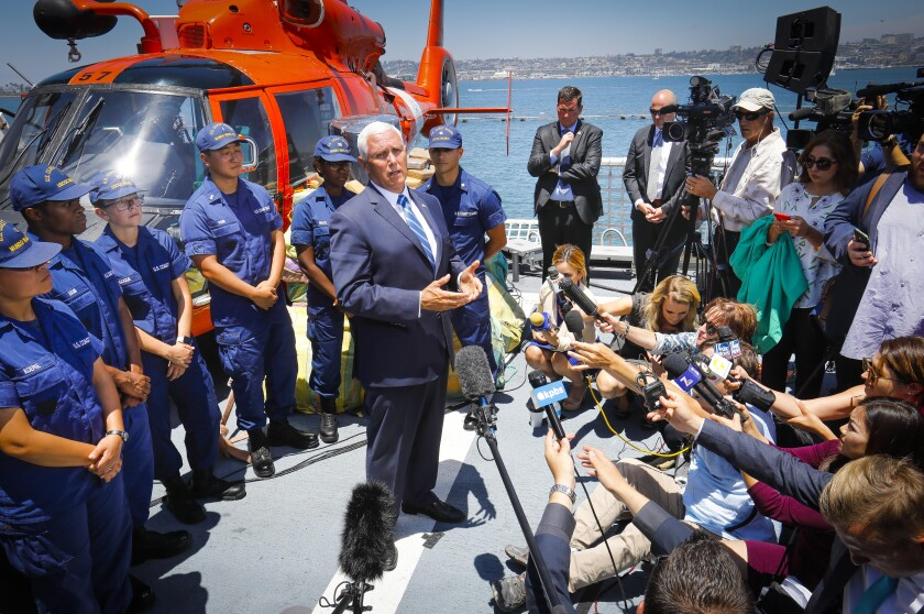 Vice President Mike Pence talks with reporters after delivering his remarks at Naval Air Station North Island onboard the U.S. Coast Guard cutter Munro, July 11, 2019, in Coronado, California during his first official trip to San Diego County since taking office. The Munro, homeported in Alameda, in Northern California, is tasked with seizing drugs in international waters. About 39,000 pounds of cocaine, and 1,000 pounds of marijuana seized in the Eastern Pacific Ocean by the Coast Guard was on display during the visit and offloaded after the Vice President left the base.
