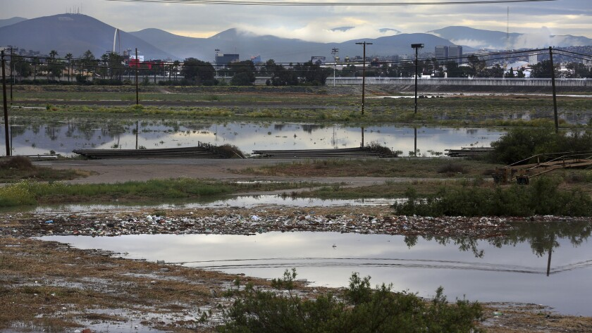 After a few days of rain during the spring, the flood plain just north of the border fence, next to a wastewater treatment plant, was full of runoff, including islands of trash.