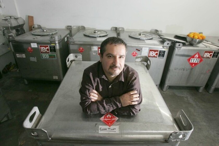 Melkon Khosrovian, CEO of Modern Spirits, stands inside an empty 350-gallon tote in the company's Monrovia warehouse.