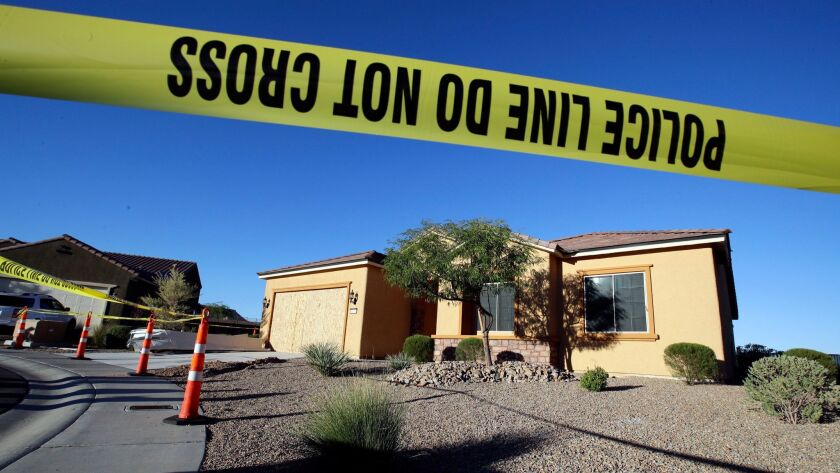 FILE - This Oct. 2, 2017 file photo shows police tape blocking off the home of Stephen Craig Paddock