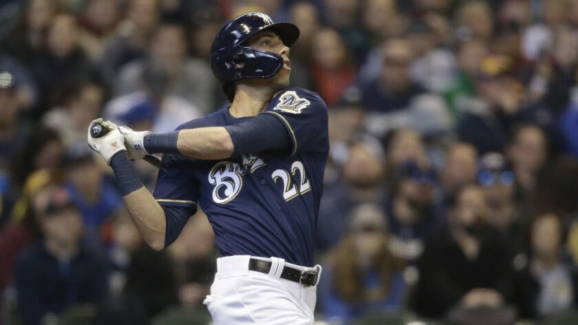 Milwaukee Brewers' Christian Yelich watches his home run against the St. Louis Cardinals during the