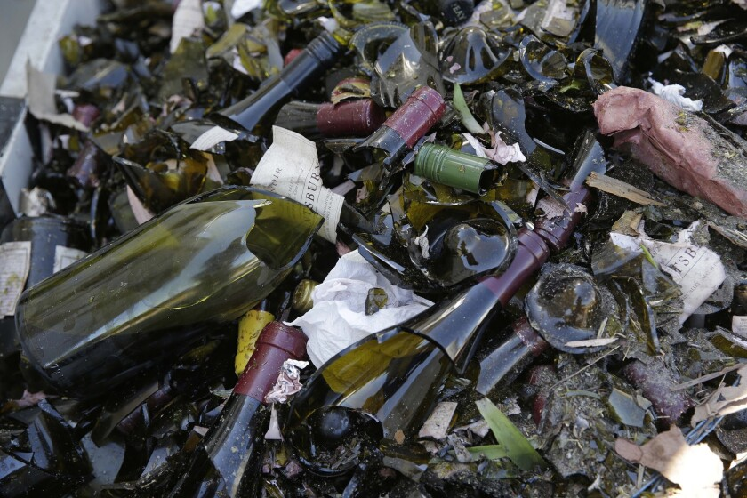 Broken bottles fill a grape bin at Saintsbury winery in Napa, Calif., after Sundays earthquake.