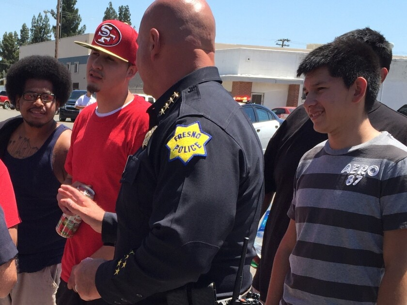 Fresno Police Chief Jerry Dyer personally speaks with protesters to ask them to disperse.