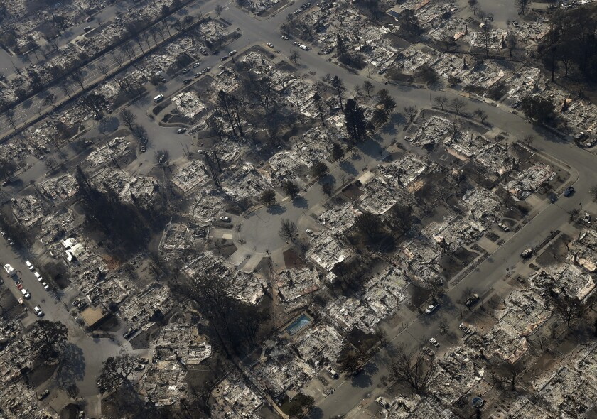 FILE — In this Oct. 11, 2017, file photo burned out homes are seen in the Coffey Park area of Santa Rosa, Calif. California Gov. Gavin Newsom wants to hire more state firefighters and make communities safer from devastating wildfires in the budget he will send to state lawmakers on Friday, Jan. 10, 2020. (AP Photo/Rich Pedroncelli, File)
