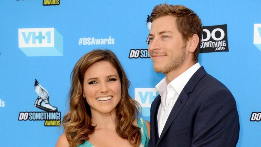 Dan Fredinburg, with then-girlfriend Sophia Bush, arrives at the Do Something Awards at the Avalon in Los Angeles in July 2013.