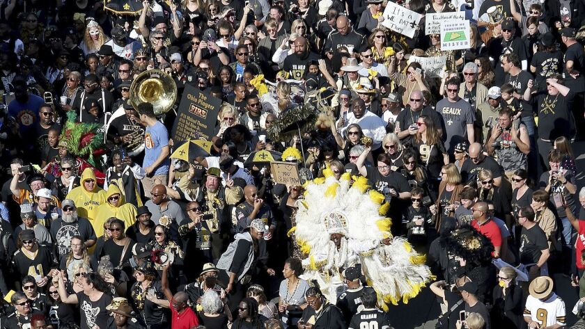 Who Dats fill North Peters Street during a parade Feb. 3 in New Orleans to protest the no-call that likely cost the Saints a spot in the Super Bowl.