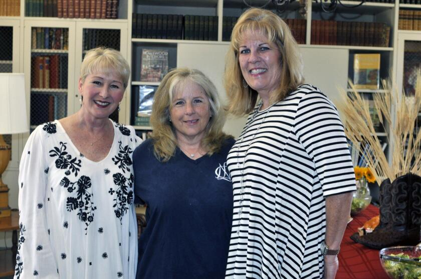 RSF Library social event co-coordinator Wendy Johnson, Andrea Coad, co-coordinator Rhonda Matty