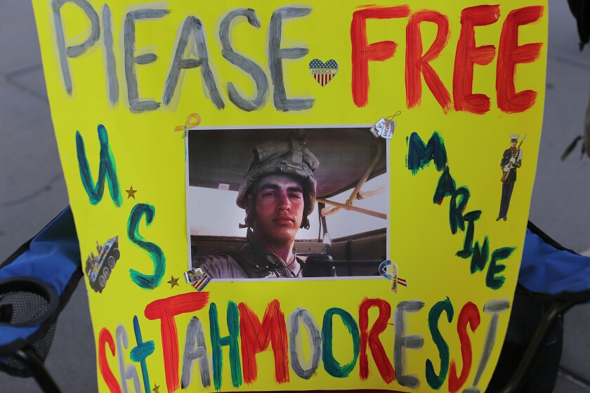 A poster from a May protest attended by about 100 people near the San Ysidro border crossing shows support for Marine reservist Sgt. Andrew Tahmooressi, who is being held in a Mexican jail on weapons charges.