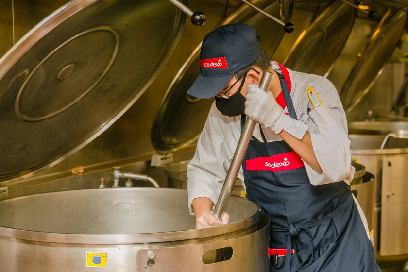 Kevin Tong, 39, stirs a giant vat of food in the mess hall kitchen at the Marine Corps Recruit Depot in San Diego.