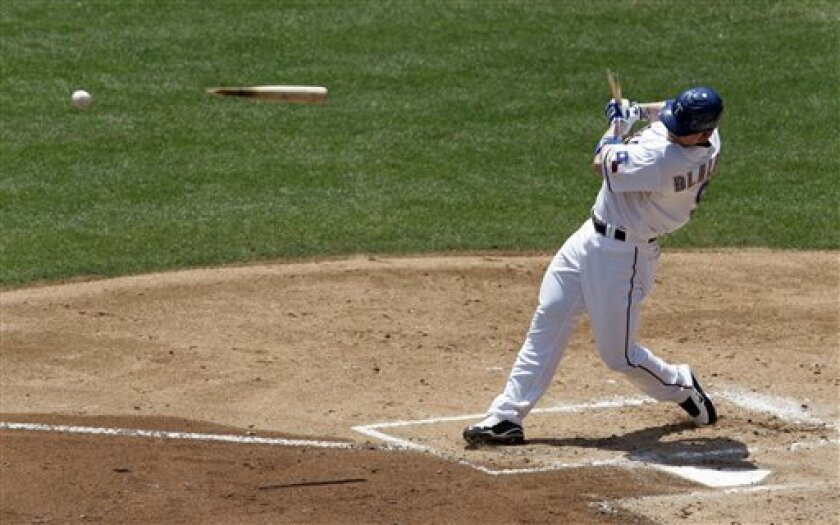 Texas Rangers' Hank Blalock breaks his bat on a ground out against Oakland Athletics pitcher Dallas Braden in the first inning of a baseball game in Arlington, Texas, Sunday, May 31, 2009. (AP Photo/Tony Gutierrez)