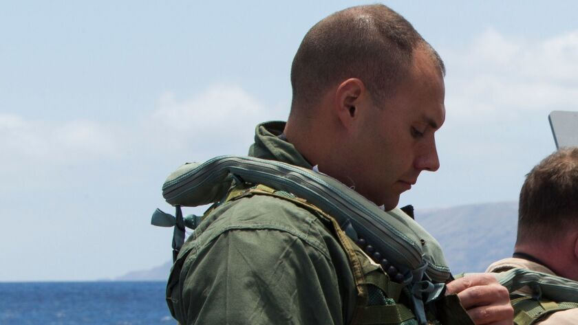 Marine Corps Capt. Jameson Hustek, an MV-22B Osprey pilot, puts on his gear before participating in a search and rescue exercise near Naval Auxiliary Landing Field San Clemente Island in 2014.
