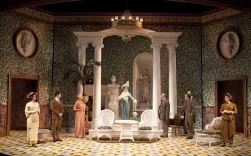 The set design beautifully recreates the look of an ornate mansion. Henry Dirocco
