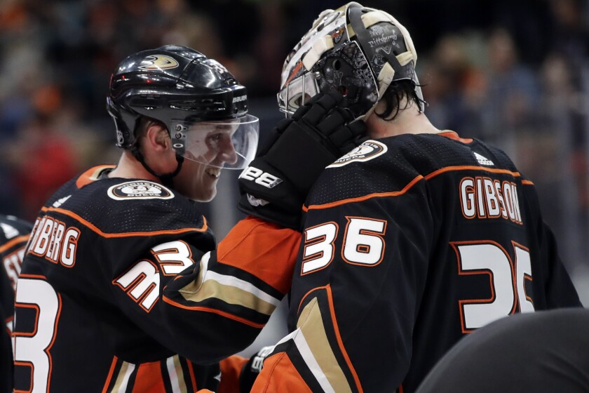 The Ducks' Jakob Silfverberg, who scored in regulation and in the shootout, celebrates with goalie John Gibson on Dec. 14, 2019.