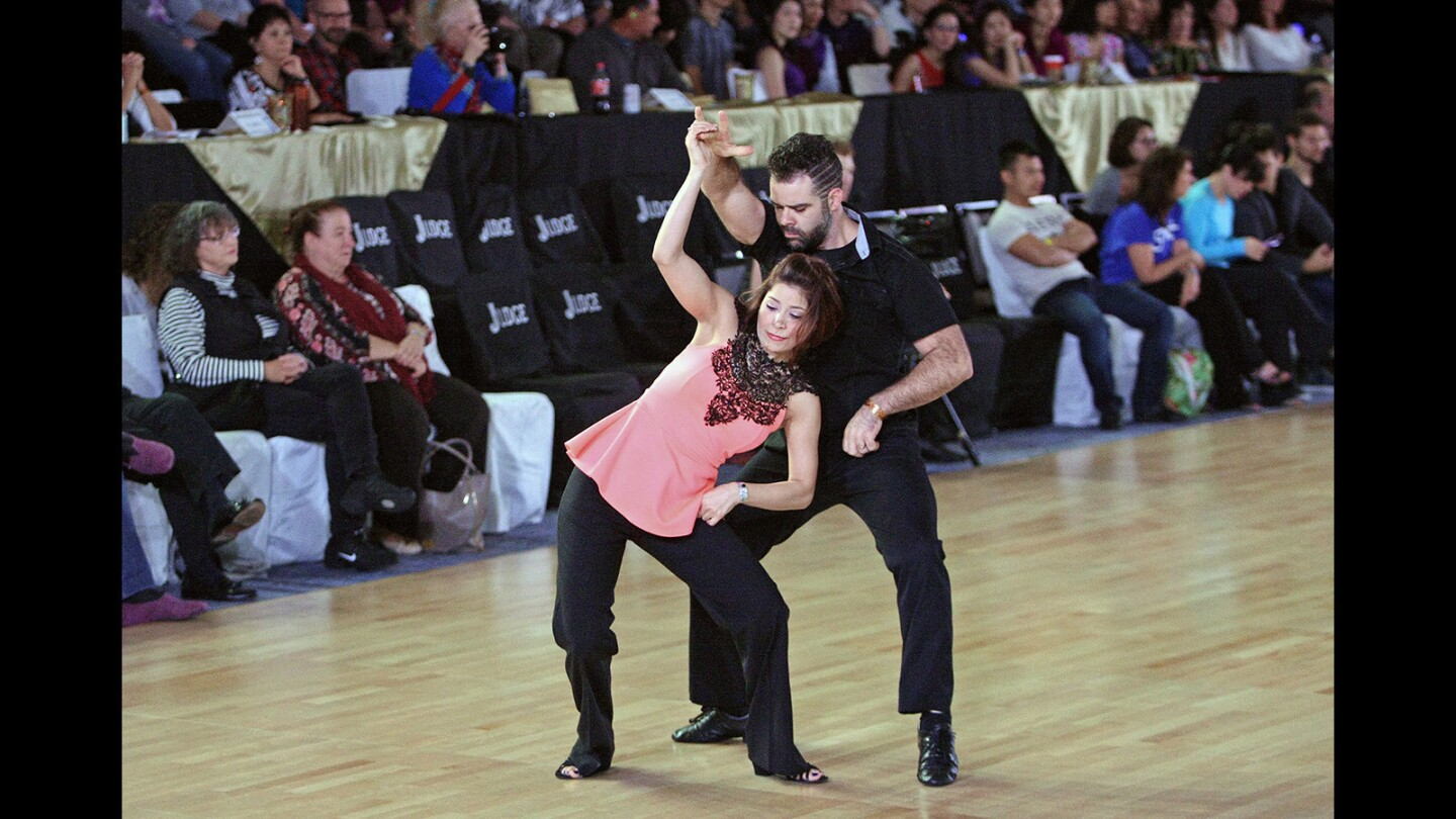 Tashina Beckmann and PJ Turner compete at the U.S. Open Swing Championships, held at the Los Angeles Marriott Burbank Airport Hotel on Wednesday, November 25, 2015.