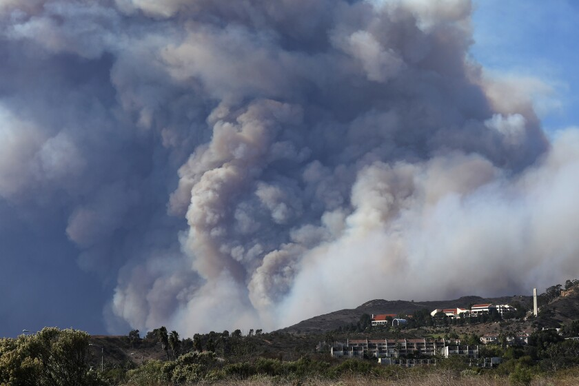 Smoke from the Woolsey fire looms over Pepperdine University and other structures in Malibu last week.