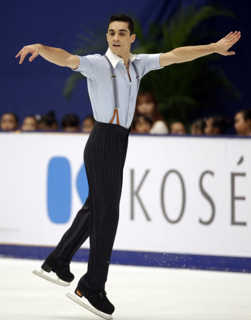 Spain's Javier Fernandez competes in the Mens Free Skating program during the ISU Grand Prix of Figure Skating at the Capital Gymnasium in Beijing, China, Saturday, Nov. 7, 2015. (AP Photo/Mark Schiefelbein)