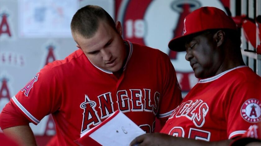 Angeles center fielder Mike Trout talks with coach Don Baylor during a game in 2015 at Angels Stadiu