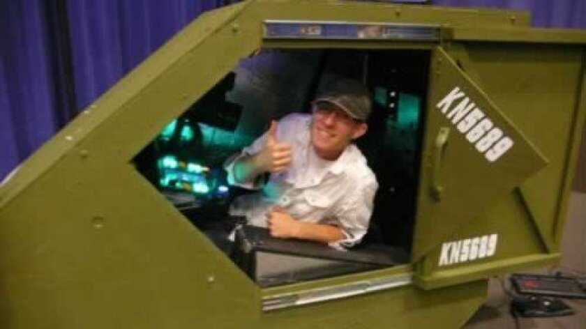 Wesley Hawkins sits in the cockpit of his combat simulator video game. Courtesy photos