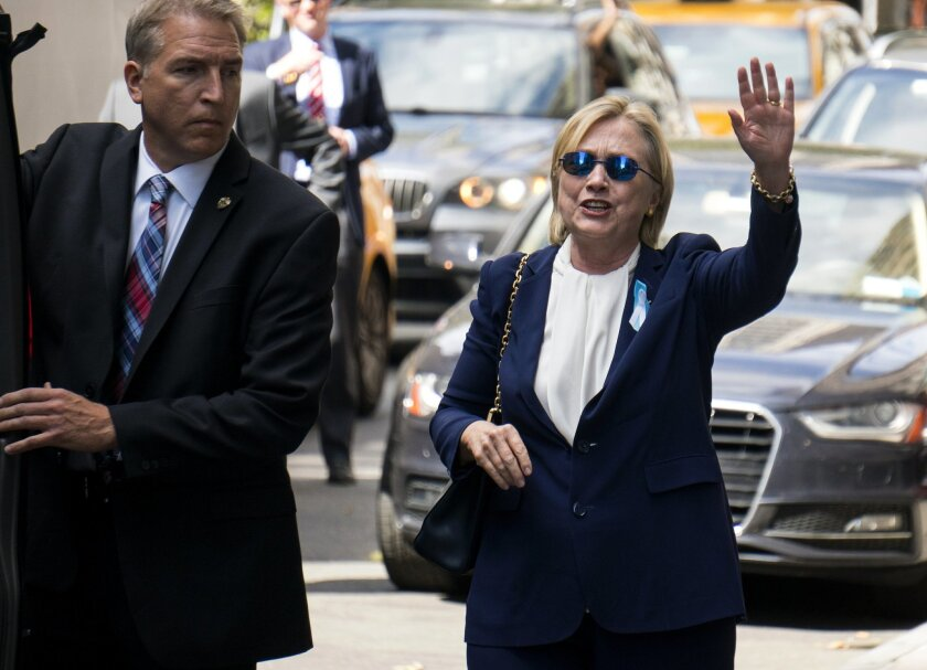 "Democratic presidential candidate Hillary Clinton walks from her daughter's apartment building Sunday, Sept. 11, 2016, in New York. Clinton unexpectedly left Sunday's 9/11 anniversary ceremony in New York after feeling ""overheated,"" according to her campaign. (AP Photo/Craig Ruttle)"