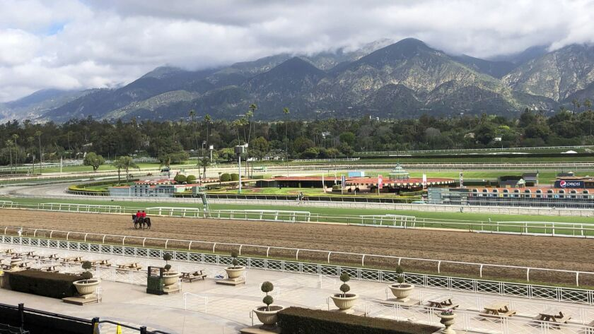 FILE - In this Thursday, March 28, 2019, file photo, a few horses and riders are seen on the track w