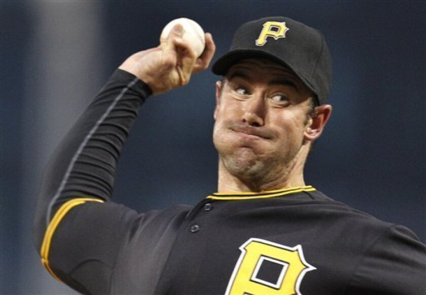 Pittsburgh Pirates pitcher Ross Ohlendorf throws in the first inning against the Colorado Rockies in a baseball game in Pittsburgh, Friday, April 8, 2011. (AP Photo/Gene J. Puskar)
