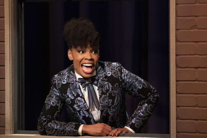 """This image released by Peacock shows Amber Ruffin from the comedy series """"The Amber Ruffin Show,"""" available on the Peacock streaming service. (Virginia Sherwood/Peacock via AP)"""