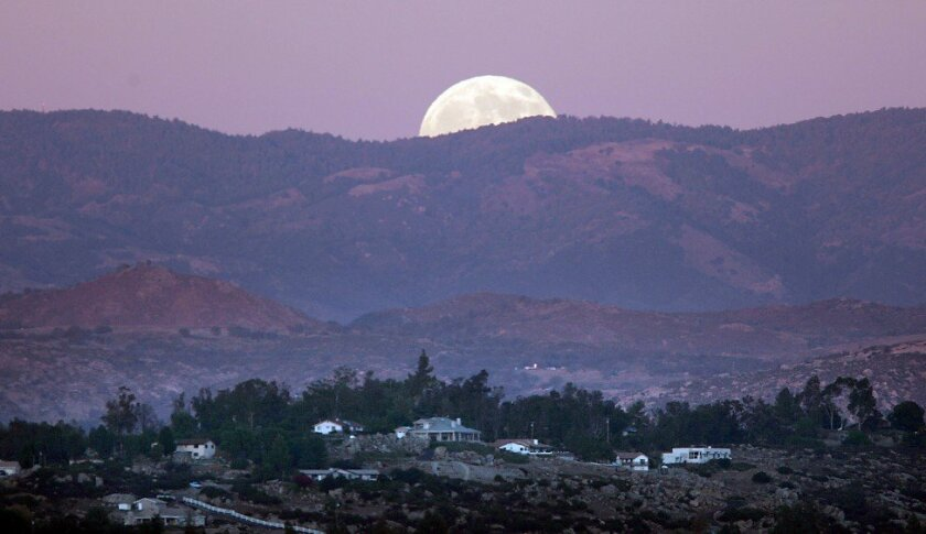 Moonrise in the hills over Ramona on Friday night.