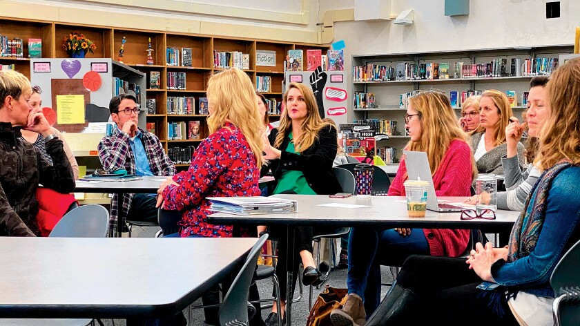 Christy Littlemore (speaking, center) leads a discussion on AB1731 that would regulate short-term vacation rentals in coastal communities, during the monthly meeting of La Jolla Cluster Association, Feb. 20, 2020 at Muirlands Middle School.