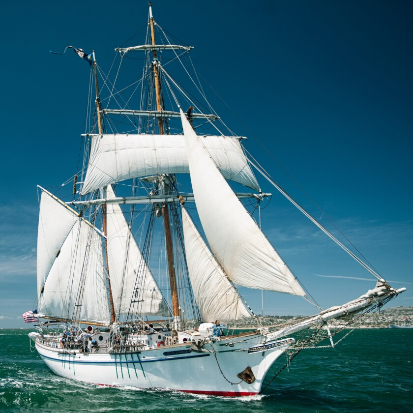 A tall ship with sails up