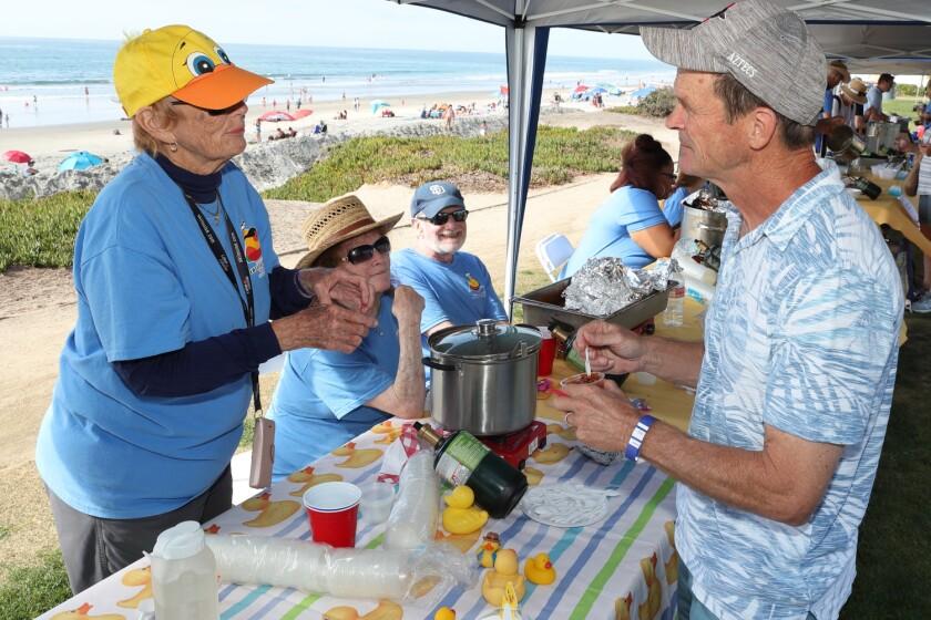 Carol Kane provides a chili sample to Steve McDowell