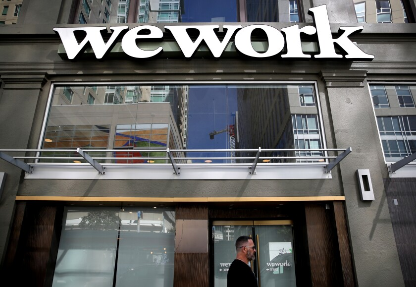 A sign is posted on the exterior of a WeWork office on Oct. 07, 2019, in San Francisco