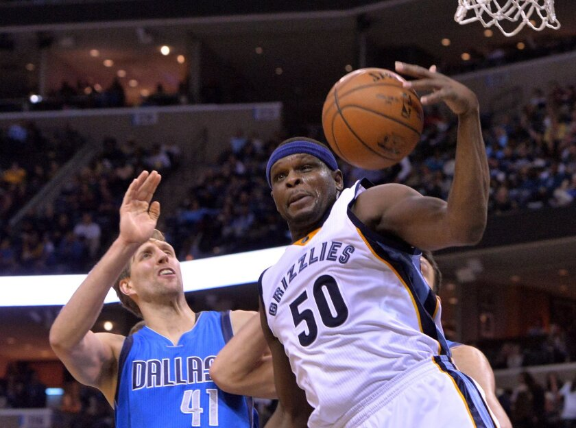 Memphis Grizzlies forward Zach Randolph (50) grabs a rebound against Dallas Mavericks forward Dirk Nowitzki (41) in the second half of an NBA basketball game Saturday, Feb. 6, 2016, in Memphis, Tenn. (AP Photo/Brandon Dill)