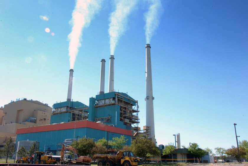 FILE - This July 1, 2013 file photo shows smoke rises from the Colstrip Steam Electric Station, a coal burning power plant in in Colstrip, Mont. The Supreme Court on Tuesday handed the Obama administration an important victory in its effort to reduce power plant pollution that contributes to unhealthy air in neighboring states. In a 6-2 decision, the court upheld a rule adopted by the Environmental Protection Agency in 2011 to limit emissions from plants in more than two-dozen Midwestern and Southern states. The pollution drifts into the air above states along the East Coast, and the EPA has long struggled to devise a way to control it. (AP Photo/Matthew Brown, File)