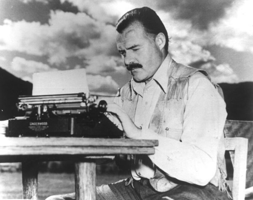 Ernest Hemingway typing at the lodge where he wrote.
