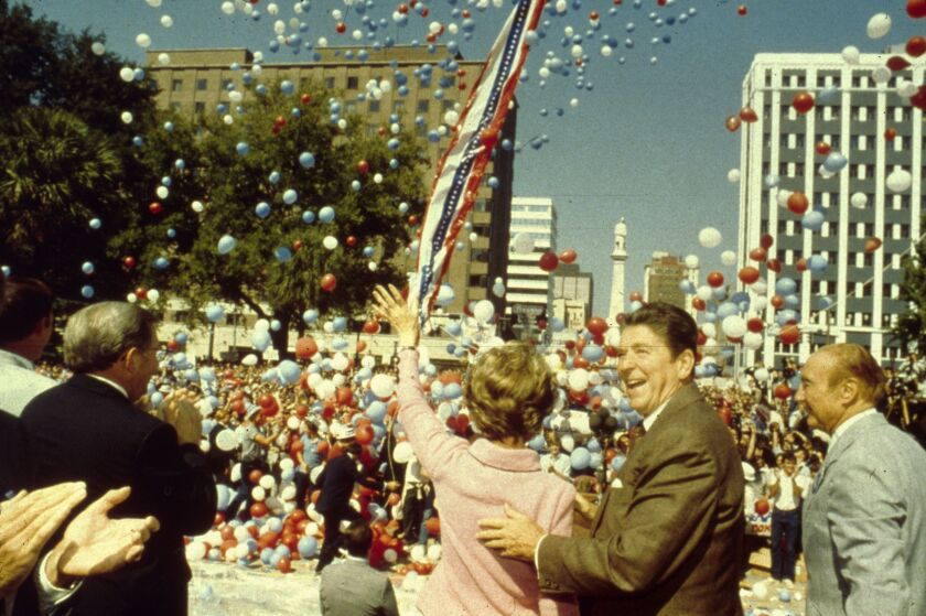 Ronald Reagan and his wife, Nancy, with Sen. Strom Thurmond to their right, campaign for president.