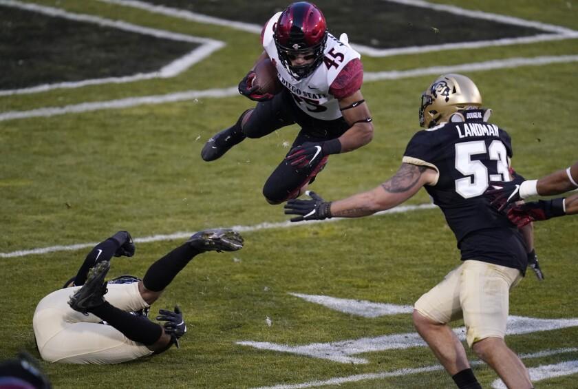 San Diego State wide receiver Jesse Matthews flies through air in game at Colorado.