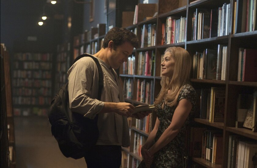 "In this image released by 20th Century Fox, Ben Affleck, left, and Rosamund Pike appear in a scene from ""Gone Girl."" The film, based on the best-selling novel, will release on Oct. 3. (AP Photo/20th Century Fox, Merrick Morton)"
