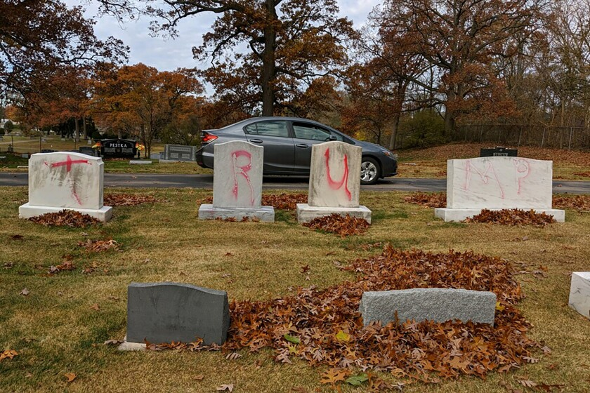 """Headstones at a Jewish cemetery in Grand Rapids, Mich., spray-painted with """"TRUMP"""" and """"MAGA."""""""