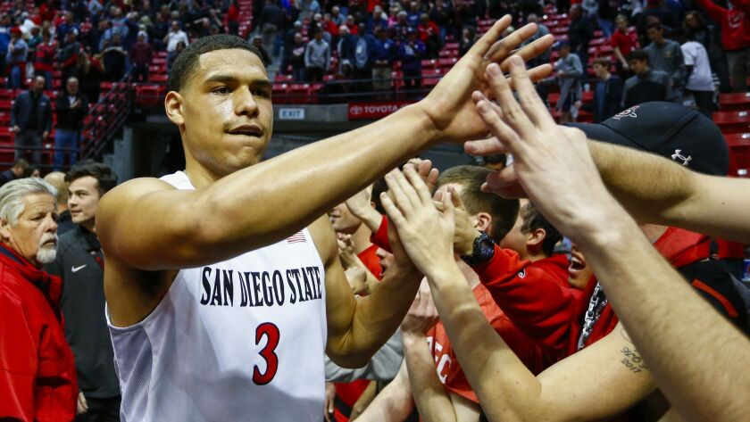 SDSU guard Trey Kell high fives fans following their victory over Nevada.