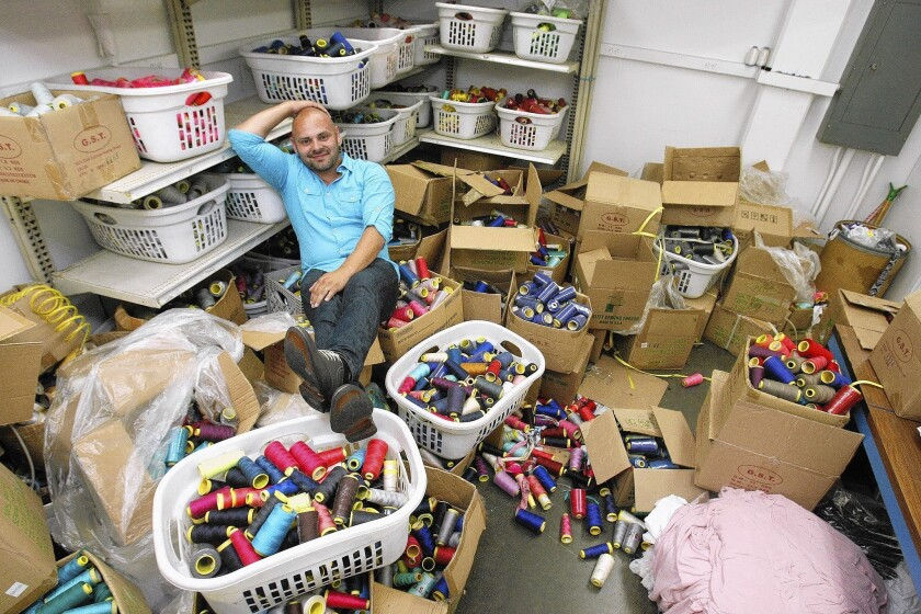 Garment broker Mike Angel Reynoso in the thread room at the Rong Li Fashion factory in Arcadia.