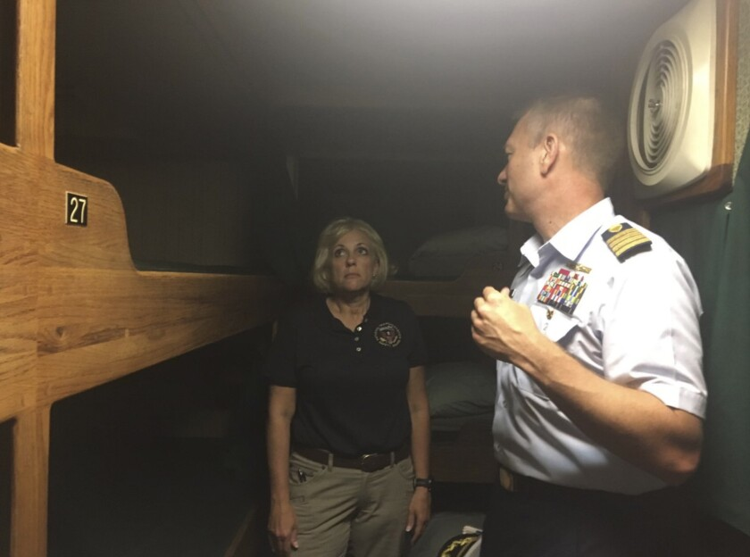 NTSB investigator Jennifer Homendy and Coast Guard Capt. Jason Neubauer tour the Vision