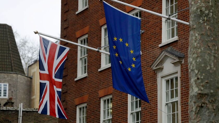 European and British Union flags hang outside Europe House, the European Parliament's offices in London, on March 20.
