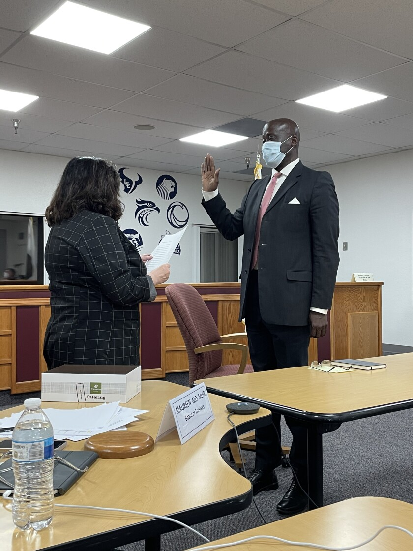 SDUHSD President Mo Muir gives the oath of office to new trustee Ty Humes.