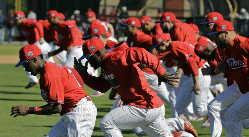 Philadelphia Phillies players run sprints during a spring training baseball workout Friday, Feb. 26, 2016, in Clearwater, Fla. (AP Photo/Chris O'Meara)