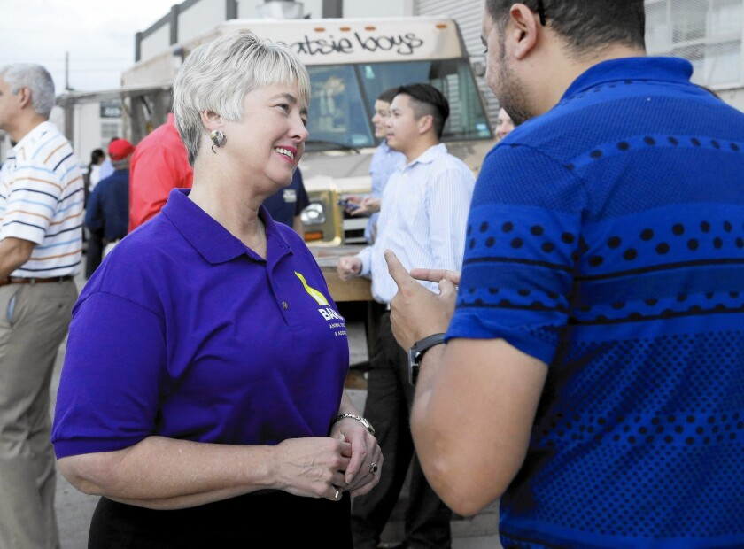 """Houston Mayor Annise Parker greets a supporter at a fundraiser for the Houston Equal Rights Ordinance last month. """"It is my life that is being discussed.... The debate is about me,"""" she said of the issue last year."""