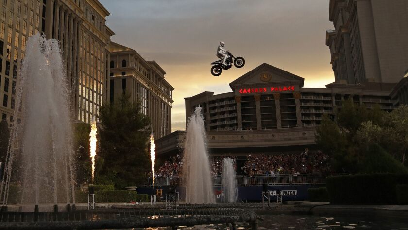 Travis Pastrana jumps the fountain at Caesars Palace on a motorcycle July 8 in Las Vegas.