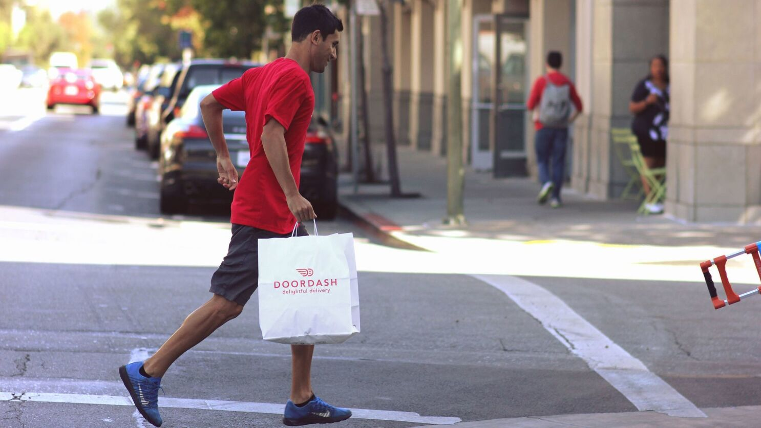 DoorDash boosts drivers' base pay and adjusts tips following an outcry