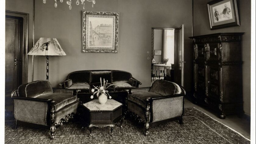 In this 1926 family photo, the Pissarro painting, center, hangs in the Berlin apartment of Lilly Cassirer Neubauer