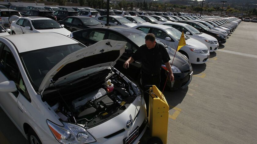 A Toyota shop foreman recharges a Prius parked in Puente Hills, Calif. on Nov. 14, 2012.